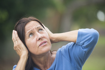 Upset stressed mature woman outdoor
