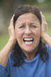 Shocked, stressed mature woman outdoor