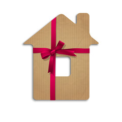 House from cardboard with ribbon and bow