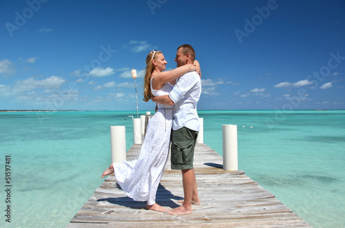 A couple on the wooden jetty. Exuma, Bahamas