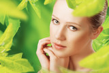beauty woman and a natural skin care in green