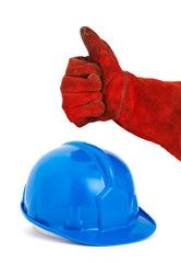 Safety helmet and hand with red glove expressing positivity with