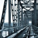 Old vintage railway bridge over river