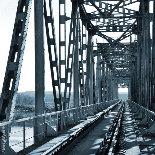 Old vintage railway bridge over river - 51599464