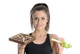 Model Released. Woman Holding Celery and Chocolates