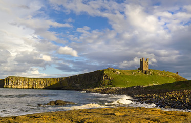 Dunstanburgh Castle viewed from the rocky shore