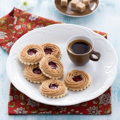 Espresso and swiss cookies filled with fruit jam