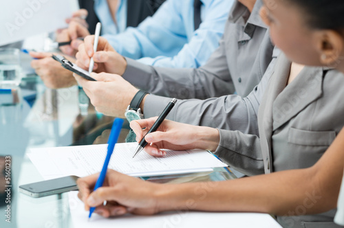 Business People Writing Note In Meeting