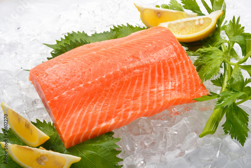 Fresh salmon with vegetables on ice
