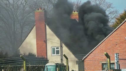 Smoke Rising from a Domestic House Fire