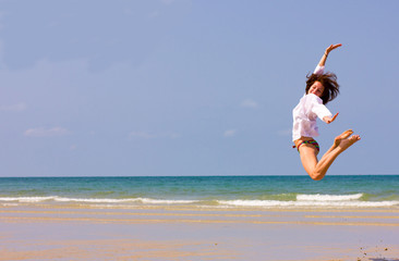 Young beautiful lady jumping over the horizon