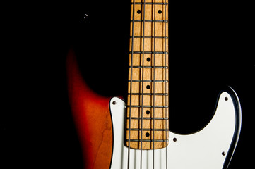 bass guitar on black background