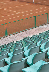 Grandstand seats and tennis court