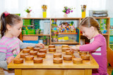 Two little girls playing in checkers