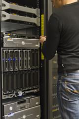 Technician installing server