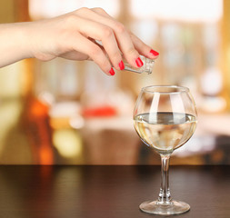 Pour something into glass with drink