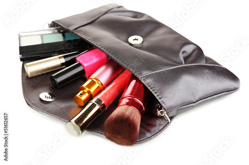 Items contained in the women's handbag isolated on white