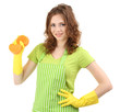 Young woman wearing green apron and rubber gloves with sponge,