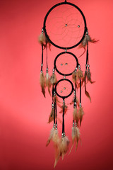 Beautiful dream catcher on red background