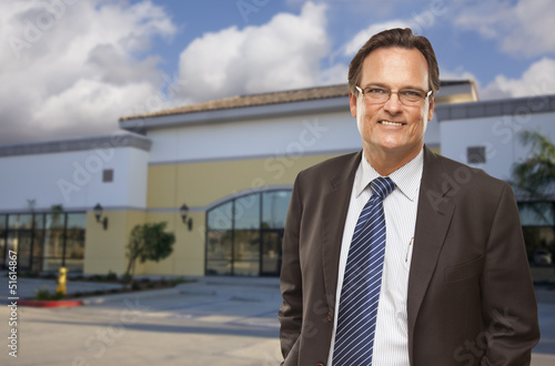 Businessman In Front of Vacant Office Building.