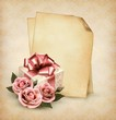 Retro holiday background with pink roses and gift box and old pa