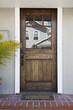 Wooden front door of an upscale home