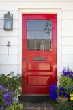 Red front door of an upscale home