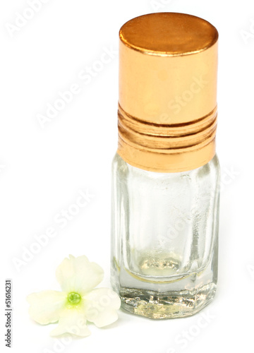 Essence bottle with white flower