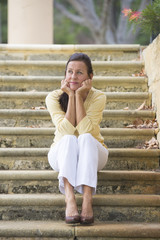 Mature woman looking stressed and lonely