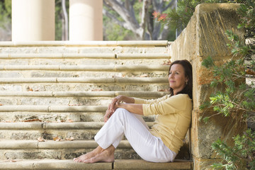 Relaxed happy mature woman outdoor