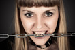 portrait of a brutal woman with a chain in teeth