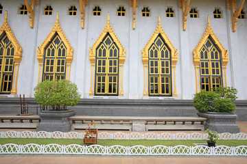 Windows and wall of wat Sothon in Chachoengsao