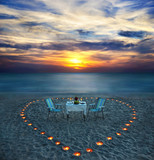 romantic dinner on sea beach with candles