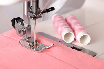 sewing process of rosy cloth on the machine and two bobbins
