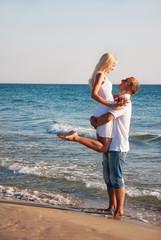 loving couple hug on sea sand beach