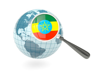 Magnified flag of ethiopia with blue globe