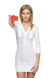 Woman in white dress holding empty credit card