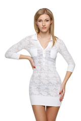 Woman in white lacy dress over white background posing