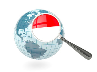 Magnified flag of indonesia with blue globe