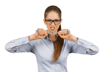 Young woman trying to break a steel chain