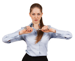 Young woman trying to break a metal chain