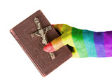 Fototapety Old hand (woman) holding a very old bible, rainbow flag