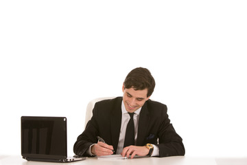 Smiling businessman writing notes