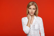 Closeup of a woman in white over red background