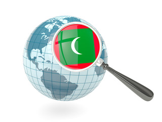 Magnified flag of maldives with blue globe