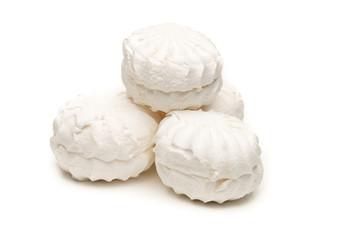 Marshmallows over white background
