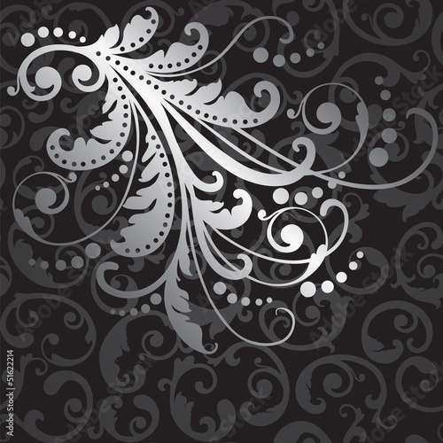 Floral silver design element on black swirls pattern