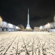 snowy winter night in Riga park and Milda - the monument of free