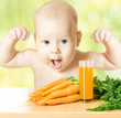 Child and fresh carrot juice glass. healthy vegetable food