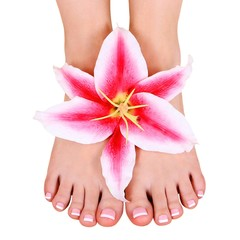 pedicure. beautiful female feet with lily flower isolated